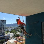 Painting overhang at Royal Harbour Apartments, Cairns.